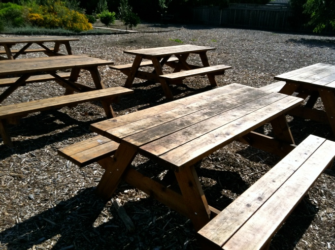 redwood tables with benches built in